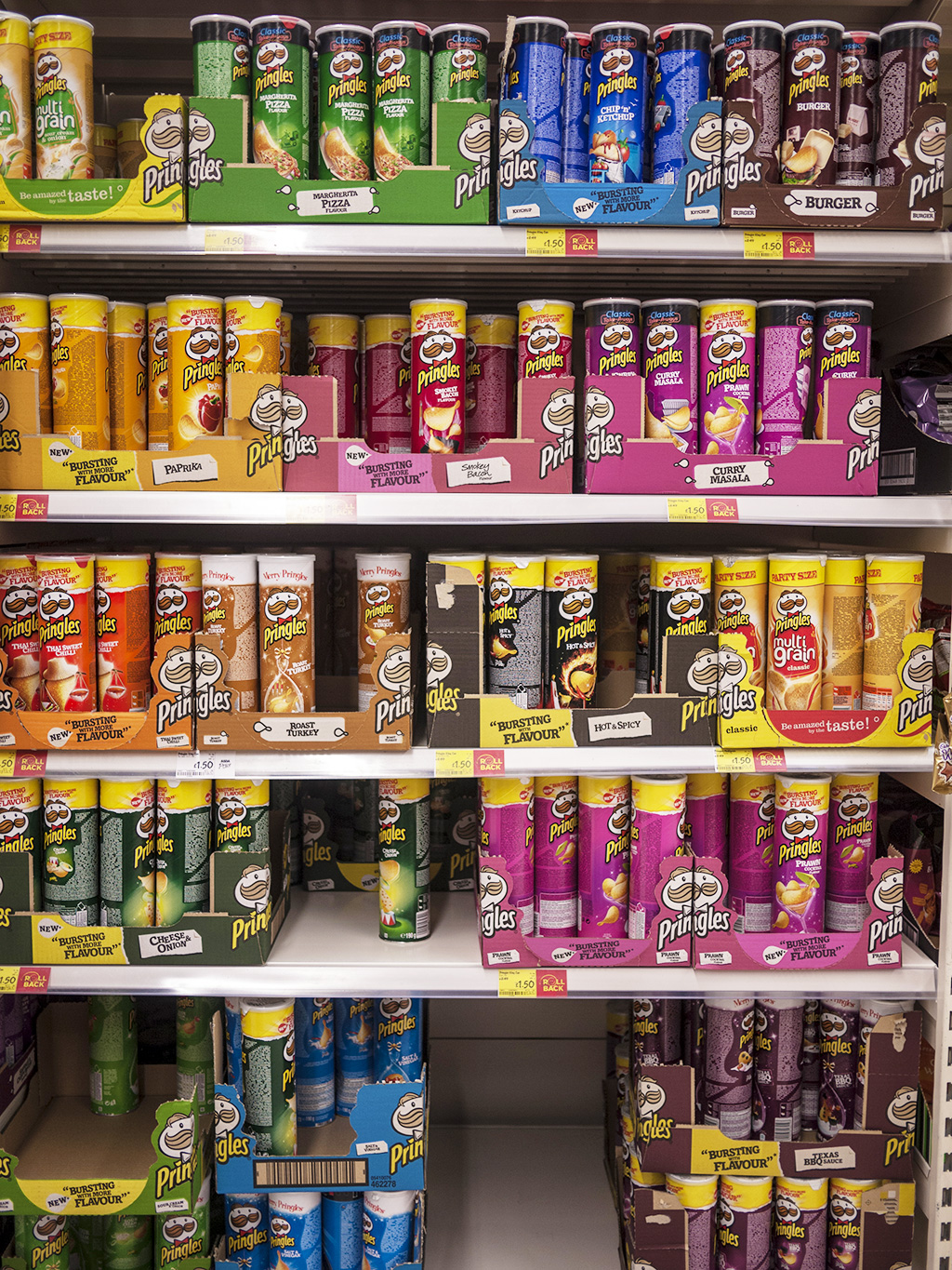 an entire shelf dedicated to Pringles flavors!